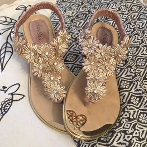 Shoes - Gold flower sandals.